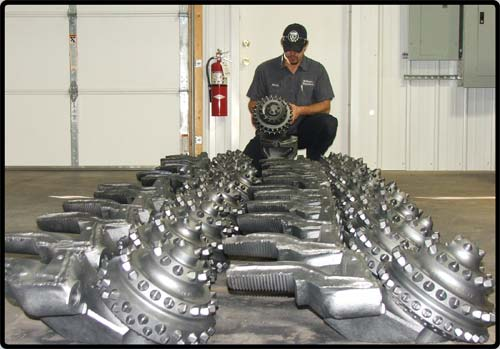 Kenny looking over some tricone cutters before being shipped out.